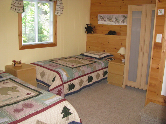 Buck Lake Cottage Rental #3-17~ bedroom downstairs with two singles and 2pc bathroom
